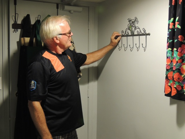 My dad hanging the one thing I actually asked him to do while I was gone: a new set of hooks in the hallway. He also painted the hallway. And waxed the floor.